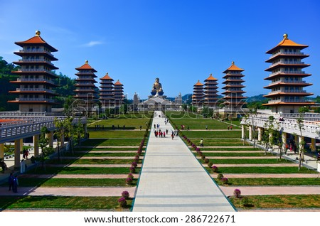Chinese temple and golden Buddha statue in Kaohsiung, Taiwan. - stock photo