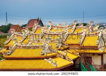 Chinese temple's roof and painting - stock photo