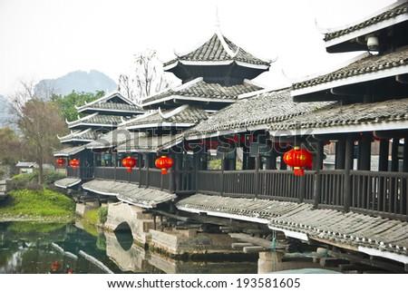 Chinese Traditional Bridge at The Shangri-La Guilin, Guilin - stock photo