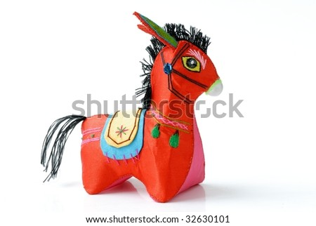 Chinese Traditional Cloth-Art --Donkey. Chinese people often sewed many lovely birds, animals, flowers and articles for daily use to make life beauty and express the wish for good life. - stock photo