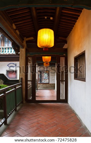 Chinese traditional corridor in wooden with yellow lantern.