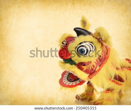 chinese traditional dancing lion on Old antique vintage paper background - stock photo