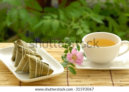 Chinese Traditional Food and Drink--Rice dumpling(zongzi) and herbal tea. - stock photo