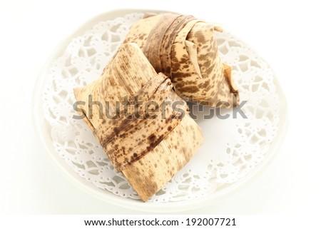 Chinese traditional food, frozen Zongzi on dish - stock photo