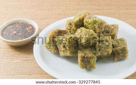Chinese Traditional Food, Plate of Fried Chinese Pancake or Fried Steamed Dumpling Made of Garlic Chives, Rice Flour and Tapioca Flour Served with Spicy Soy Sauce. - stock photo