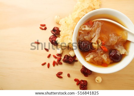 Chinese traditional white fungus or snow fungus soup over wooden table background