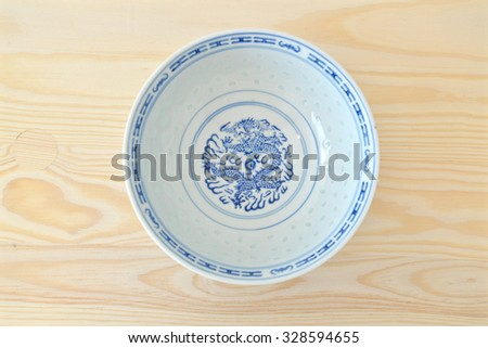 Chinese vintage style blue and white bowl on the cupboard at home.  - stock photo