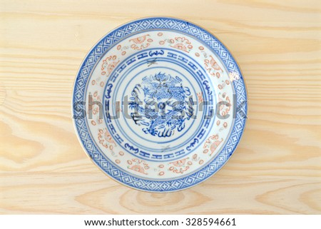 Chinese vintage style blue and white plate on the cupboard at home.  - stock photo