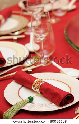 Chinese wedding banquet table setting - stock photo