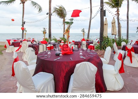 chinese wedding banquet table setting by the beach