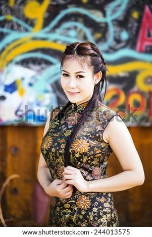 Chinese woman back dress traditional cheongsam - stock photo