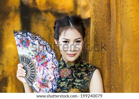 Chinese woman back dress traditional cheongsam ,close up portrait - stock photo
