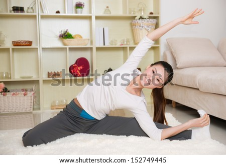 chinese woman doing yoga at home