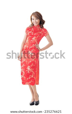 Chinese woman dress traditional cheongsam at New Year, full length portrait isolated. - stock photo