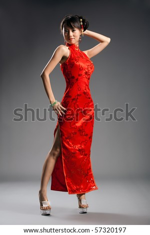 Chinese woman in cheongsam with studio background