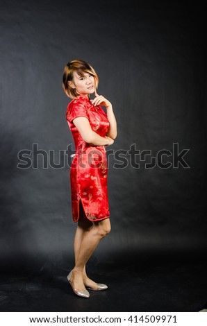 chinese woman in red National dress