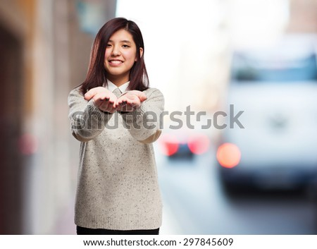 chinese woman offering gesture - stock photo