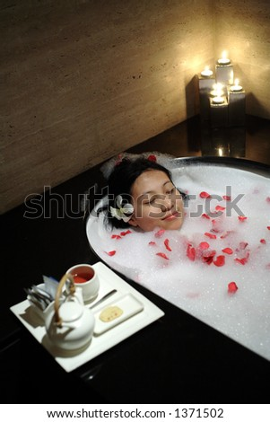 Chinese woman relaxing at the resort SPA
