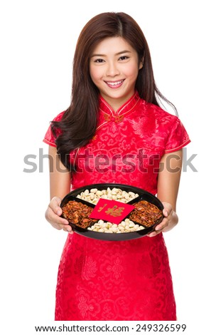 Chinese woman show with snack tray - stock photo