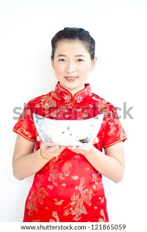 chinese woman wear cheongsam and holding silver ingot