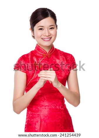 Chinese woman with celebration hand gesture