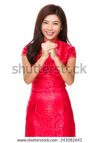 Chinese woman with congratulation gesture - stock photo