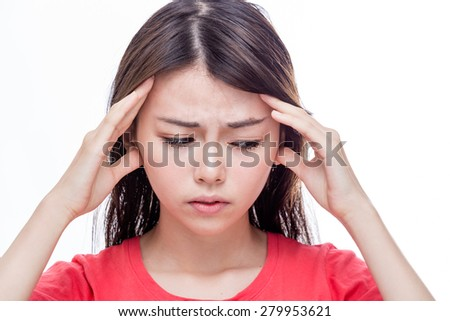 Chinese woman with headache, putting hands on temples