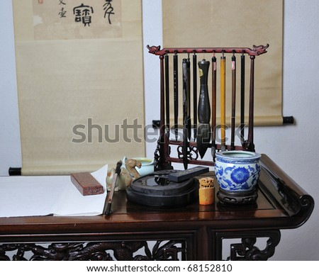 Chinese writing brushes and inkstone on the table - stock photo