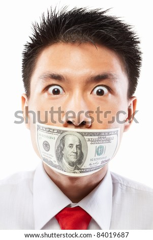 Chinese young man with his mouth sealed by a hundred dollar bills for bribe concept - stock photo