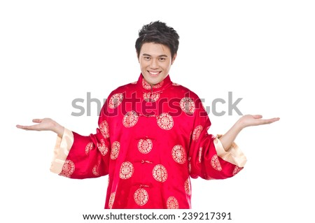 chinese young man with tradition clothing with his hands into the air - stock photo