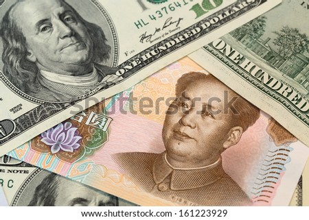 Chinese yuan and us 100 dollar close up view as a background - stock photo