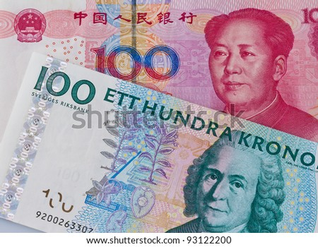 chinese yuan banknotes and swedish crowns. different currencies - stock photo