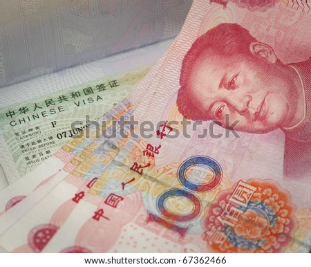 Chinese100 yuan bills and visa - stock photo