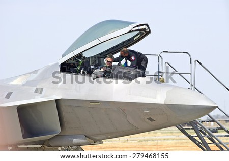CHINO/CALIFORNIA - MAY 3, 2015: Lockheed Martin F-22 Raptor stealth tactical fighter aircraft piloted by Captain John Cummings on the runway at the Planes of Fame Airshow in Chino, California USA