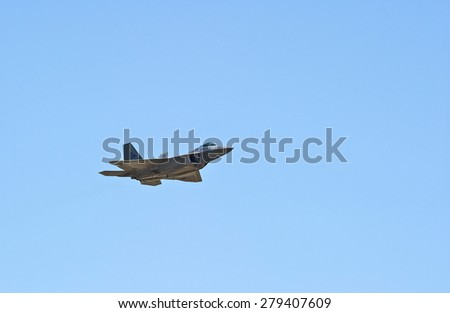 CHINO/CALIFORNIA - MAY 3, 2015: Lockheed Martin F-22 Raptor stealth tactical fighter displaying its flying agility at the Planes of Fame Airshow in Chino, California USA  - stock photo