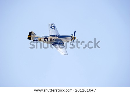 CHINO/CALIFORNIA - MAY 3, 2015: Vintage military aircraft displaying its flying agility at the Planes of Fame Airshow in Chino, California USA