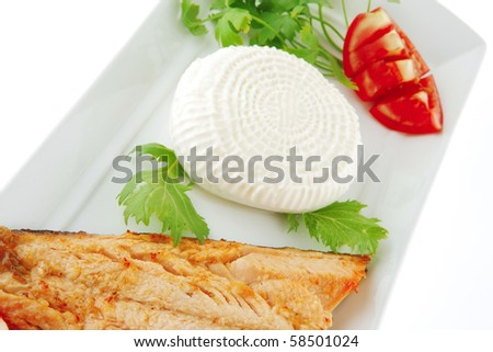 chinook steak and cheese on white plate with tomatoes - stock photo