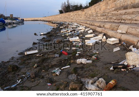 CHIOGGIA, ITALY - DECEMBER, 31: View of domestic garbage next to the sea on December 31, 2015 - stock photo