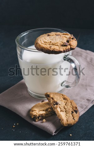 Chip chocolate cookies and glass of milk,selective focus  - stock photo