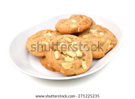 chip cookies with nuts on plate isolated on white  - stock photo