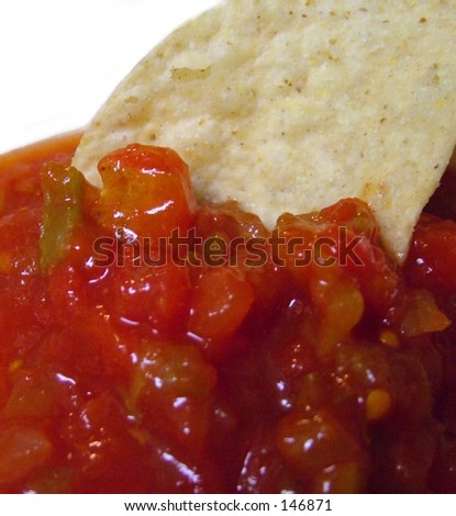 Chip in chunky salsa - stock photo