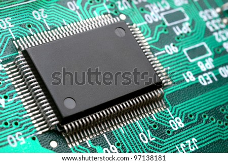 Chip on circuit board closeup - stock photo