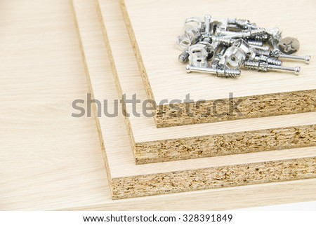 Chipboard and furniture accessories - stock photo