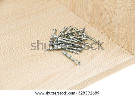 Chipboard with confirmat screws - stock photo