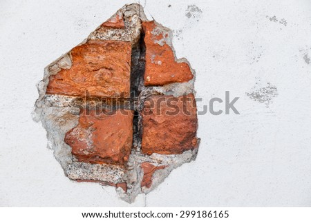 chipped concrete and brick wall an old building - stock photo