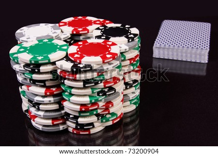 Chips and a pack of card - stock photo