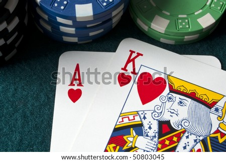 chips and ace king hand on a gambling table - stock photo