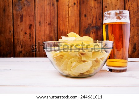 Chips and beer - stock photo