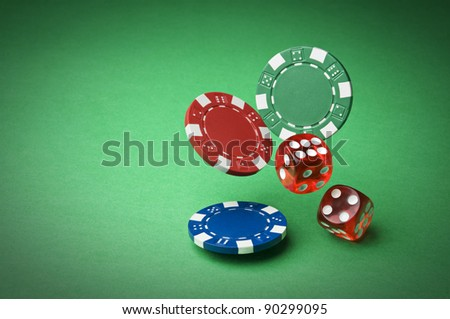 Chips and dices on green background close up - stock photo