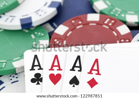 chips and four aces of a kind, poker
